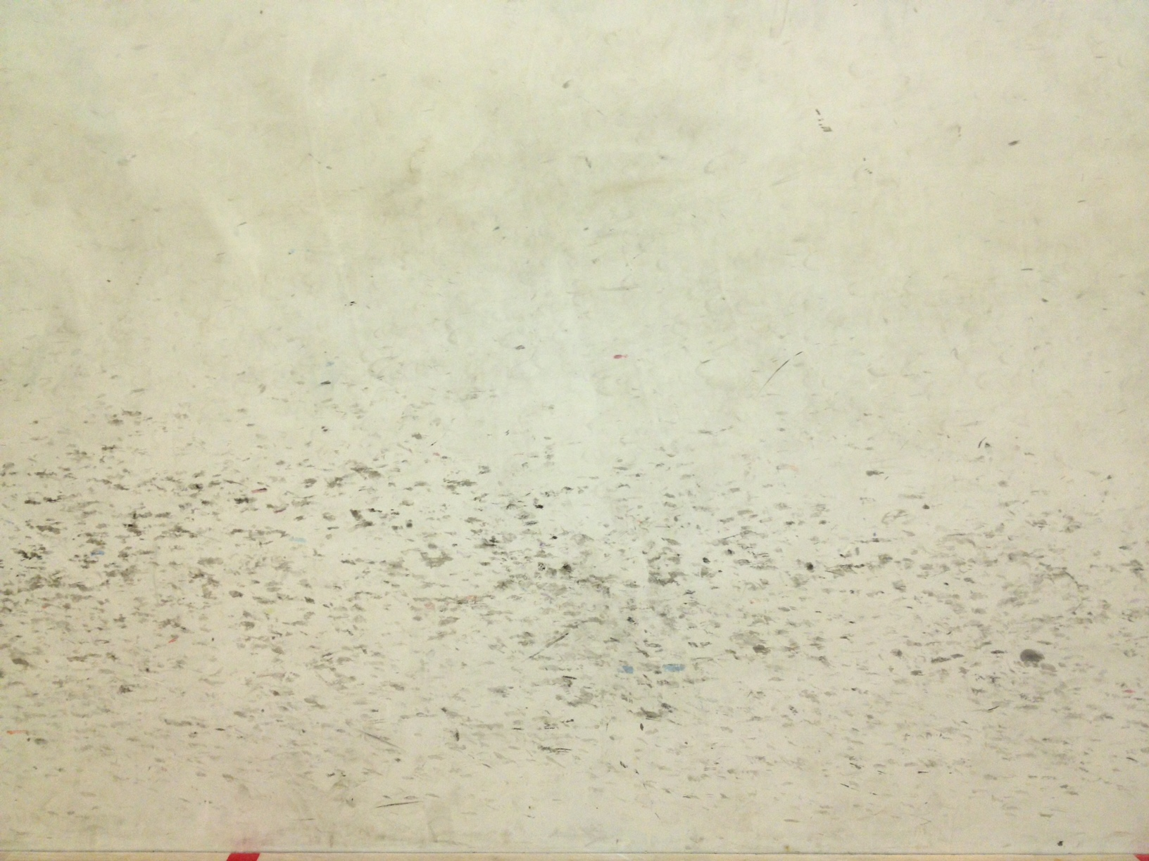 Squash court wall covered in ball markings